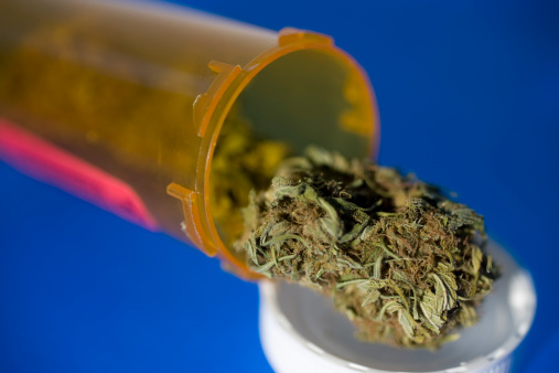 Marijuana falling out of a pill container