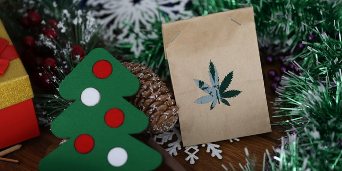 christmas cookies and a brown paper bag with marijuana leaf on it