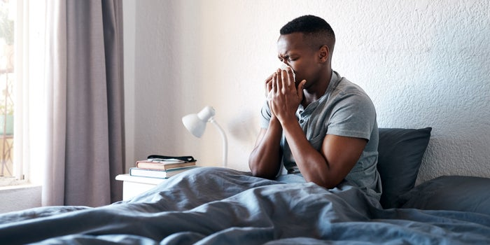 man in bed with flu