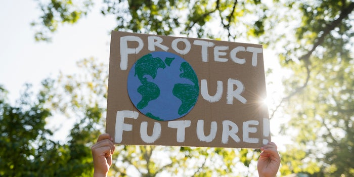 "sign that reads ""protect our future"" with an earth cartoon"