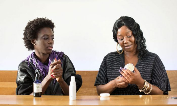 two women discussing products