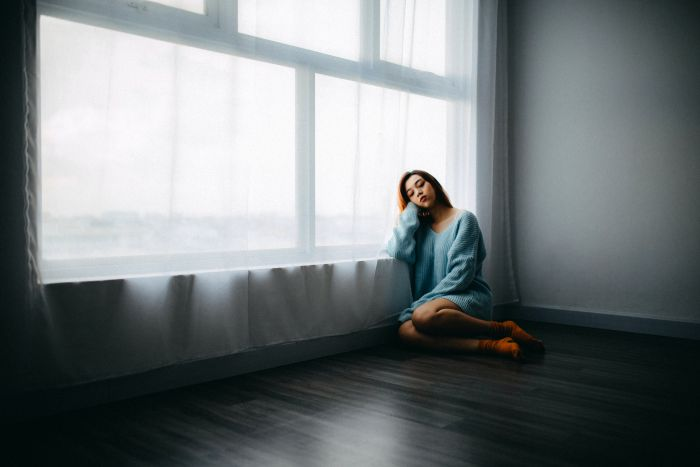 girl alone in an empty room