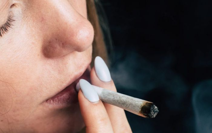 woman smoking a joint