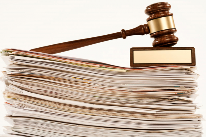 gavel on stack of papers