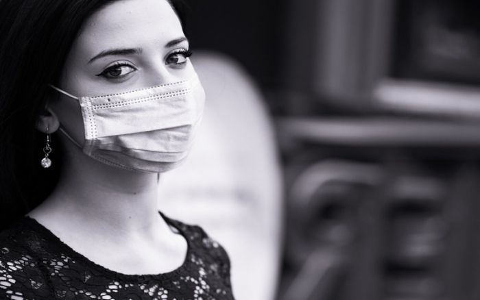 woman with face mask in black and white