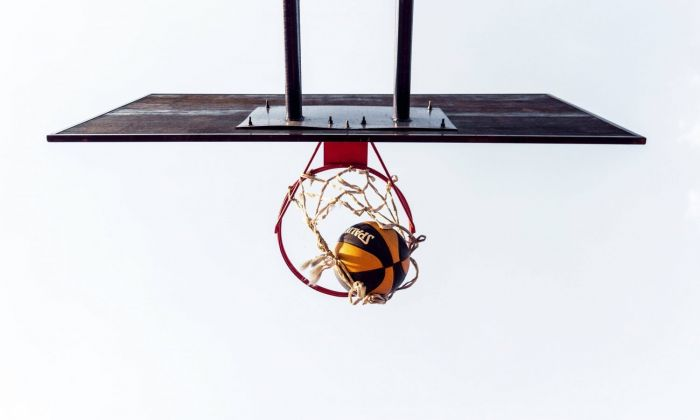 top down view of a basketball hoop, with a ball going through it