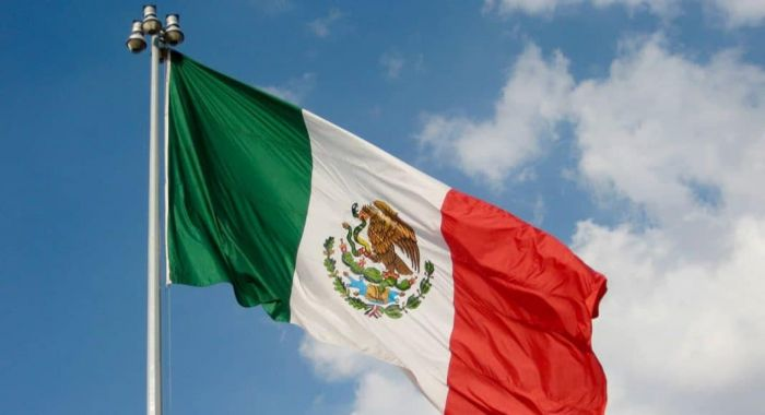 mexican flag with a blue sky