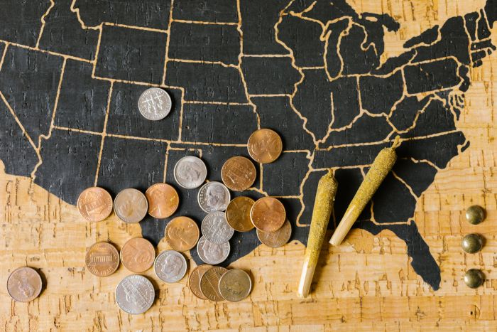 USA map with cannabis and coins