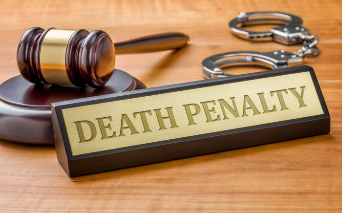 name plate that reads Death Penalty, and legal gavel on a desk