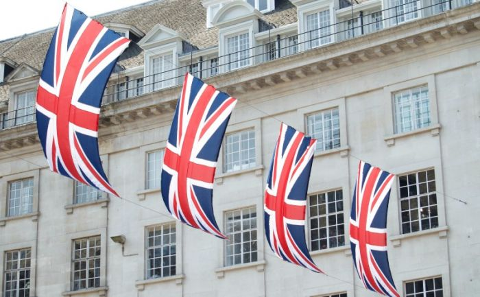 union flags strung across a building, blowing in the wind