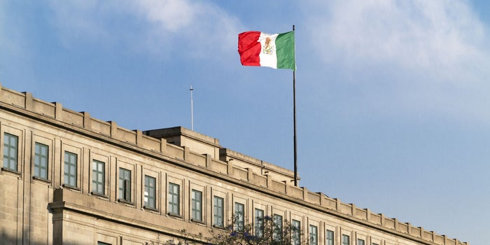 the mexican flag above a building