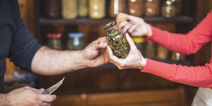 people handing over cannabis at a store