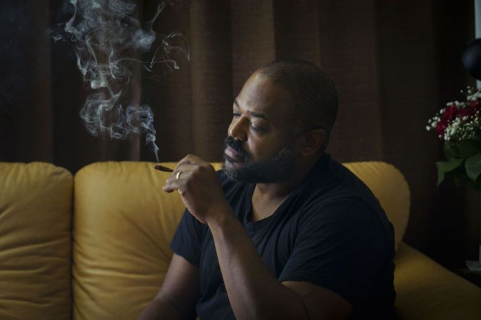 Man sat on couch smoking