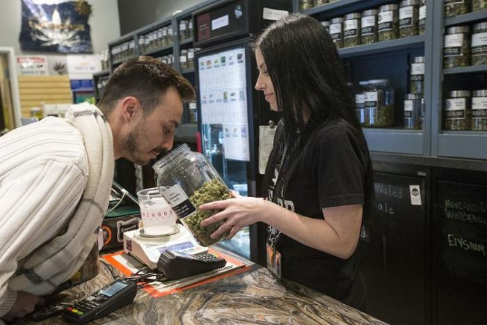 person buying cannabis from a dispensary
