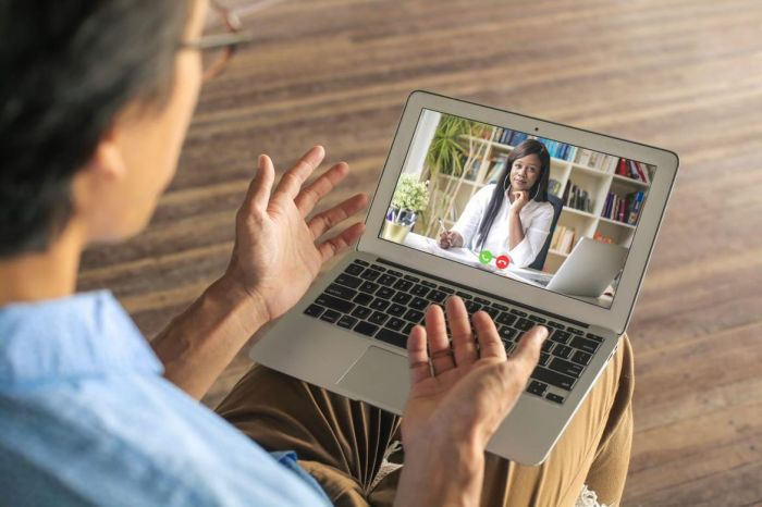 person meeting with doctor through laptop