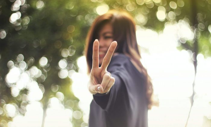 woman giving the peace sign