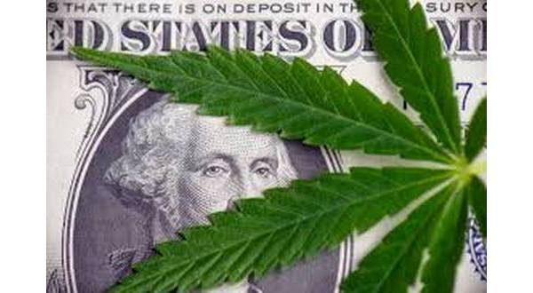 money with a cannabis leaf