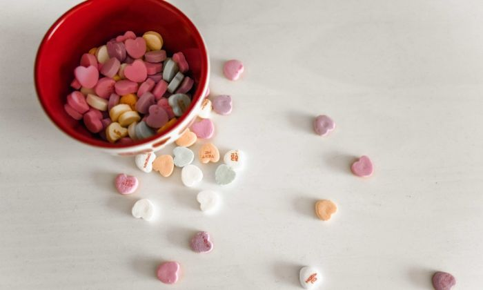 dish of heart shaped candy spilled over table
