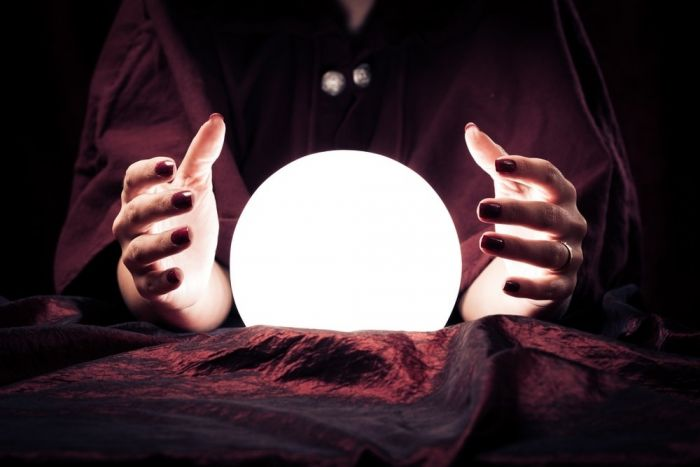 someone holding a glowing crystal ball
