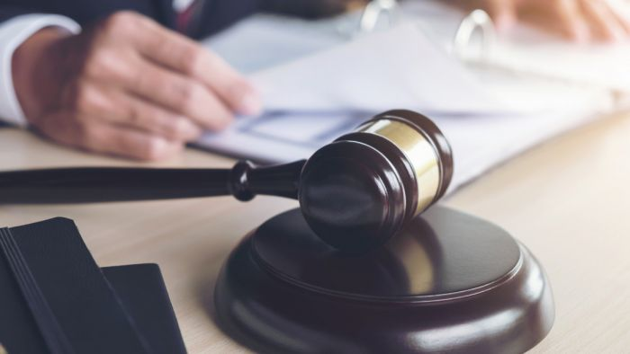 legal gavel on the table against legal documents