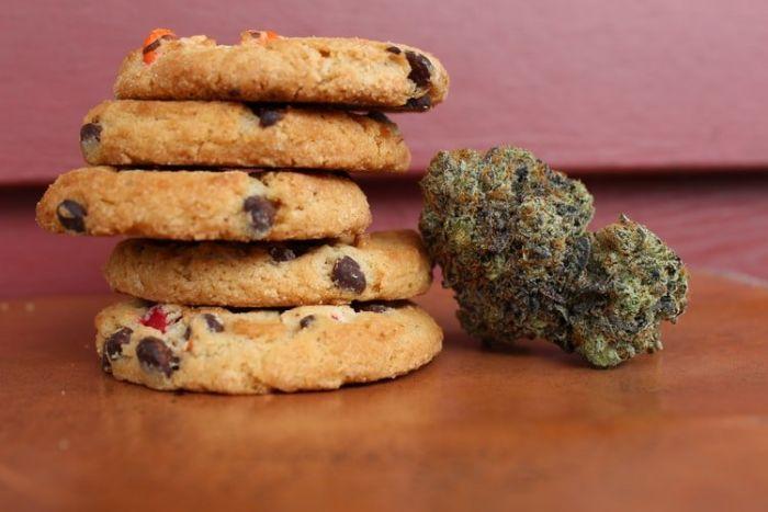 stack of cookies with cannabis next to