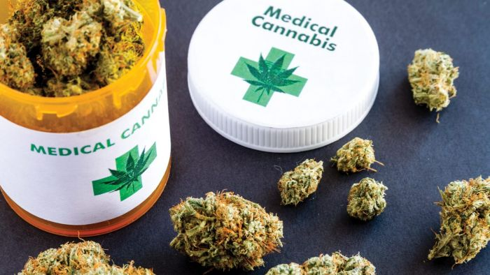 medical bottle filled with cannabis buds