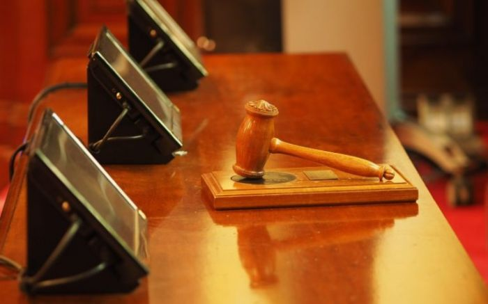 legal gavel laying on the desk of a courthouse