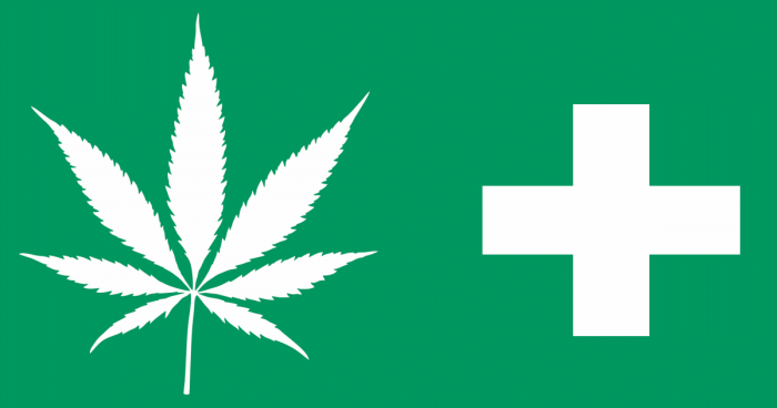green background with white marijuana leaf and a white medical cross