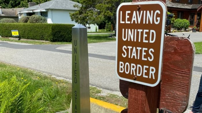 """sign that says """"leaving united states border"""""""