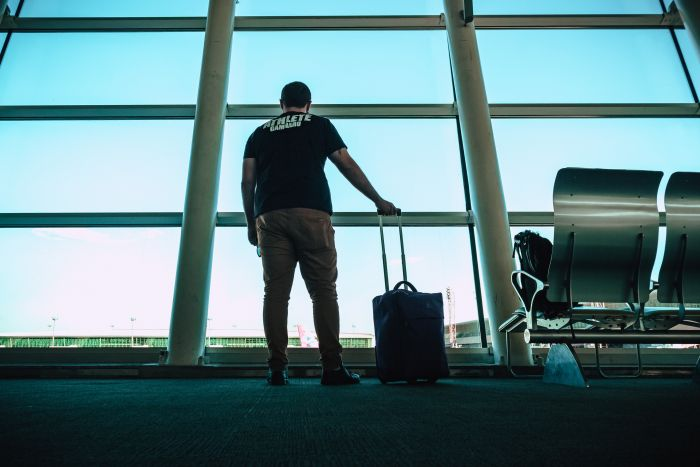 man standing in airport