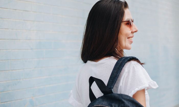 woman with a backpack smilling
