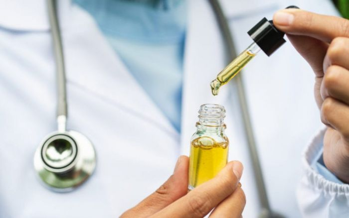 doctor with a bottle of cbd oil